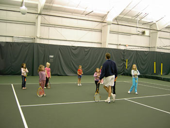 Director Michael Myers leading a junior group clinic session at the Enfield Tennis Club